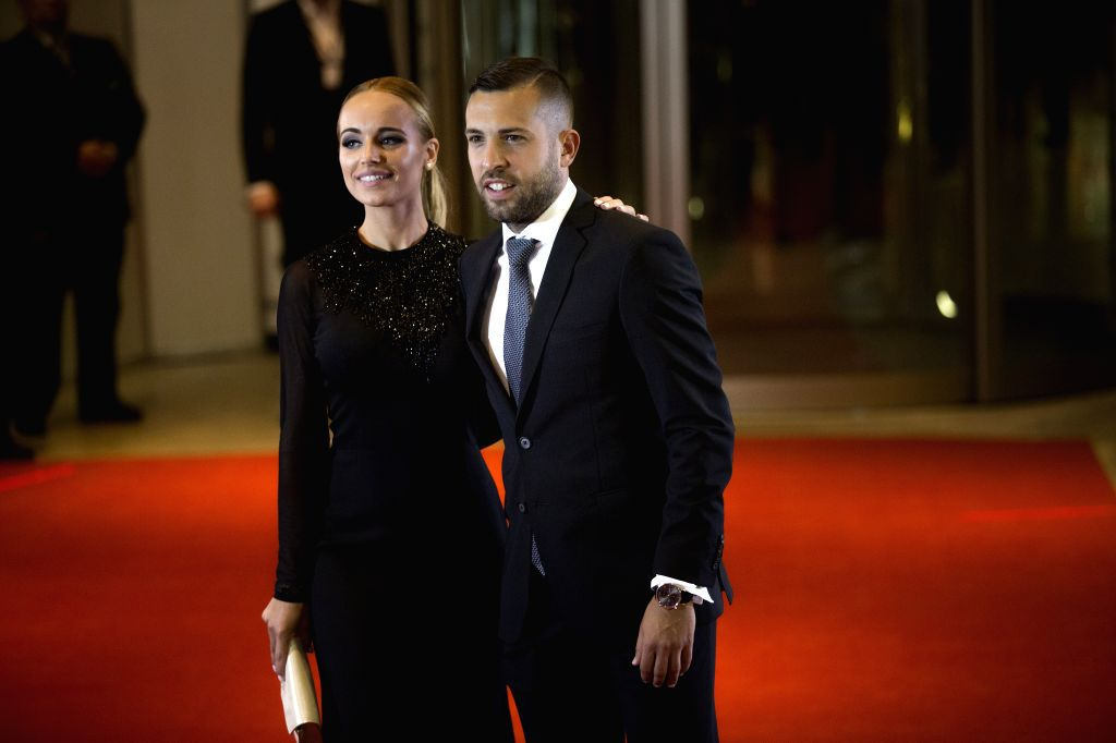 ROSARIO, July 1, 2017 - Barcelona FC's Jordi Alba(R), teammate of Argentine soccer player Lionel Messi, poses with his girlfriend Romarey Ventura as they pose for photographers as they arrive at the ...