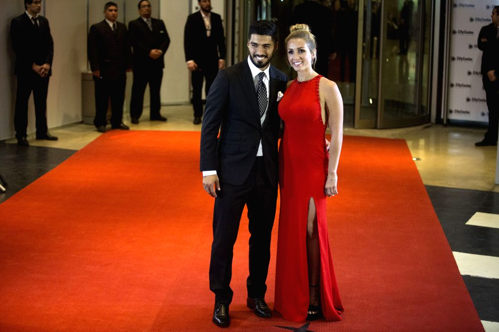 ROSARIO, July 1, 2017 - Barcelona FC's Luis Suarez(L), teammate of Argentine soccer player Lionel Messi, poses with his wife Sofia Balbi as they pose for photographers as they arrive at the wedding ...