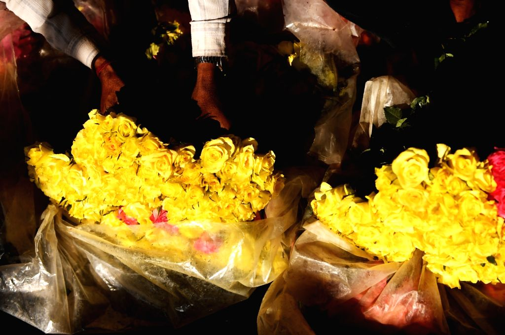 Roses ready to be dispatched to flower vendors across Kolkata from a wholesale market on the eve of Valentine's Day in Kolkata, on Feb 13, 2019.  `