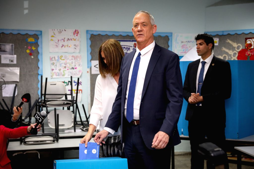 ROSH HAAYIN, April 9, 2019 - Ex-army chief Benny Gantz (front), one of the leaders of the Blue and White party, and his wife Revital Gantz cast their votes in Rosh Haayin, near Tel Aviv, Israel, on ...