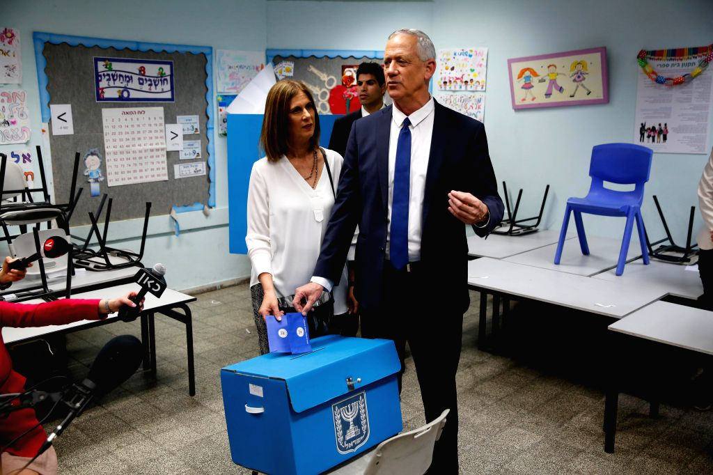 ROSH HAAYIN, April 9, 2019 (Xinhua) -- Ex-army chief Benny Gantz (R), one of the leaders of the Blue and White party, and his wife Revital Gantz cast their votes in Rosh Haayin, near Tel Aviv, Israel, on April 9, 2019. Israel on Tuesday morning start