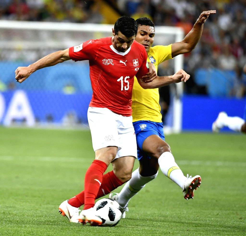 ROSTOV-ON-Blerim Dzemaili (L) of Switzerland competes during a group E match between Brazil and Switzerland at the 2018 FIFA World Cup in Rostov-on-Don, Russia, June ...