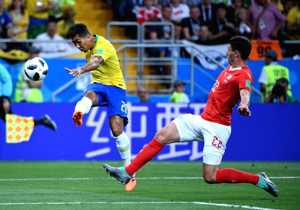 ROSTOV-ON-Roberto Firmino (L) of Brazil vies with Fabian Schaer of Switzerland during a group E match between Brazil and Switzerland at the 2018 FIFA World Cup in ...