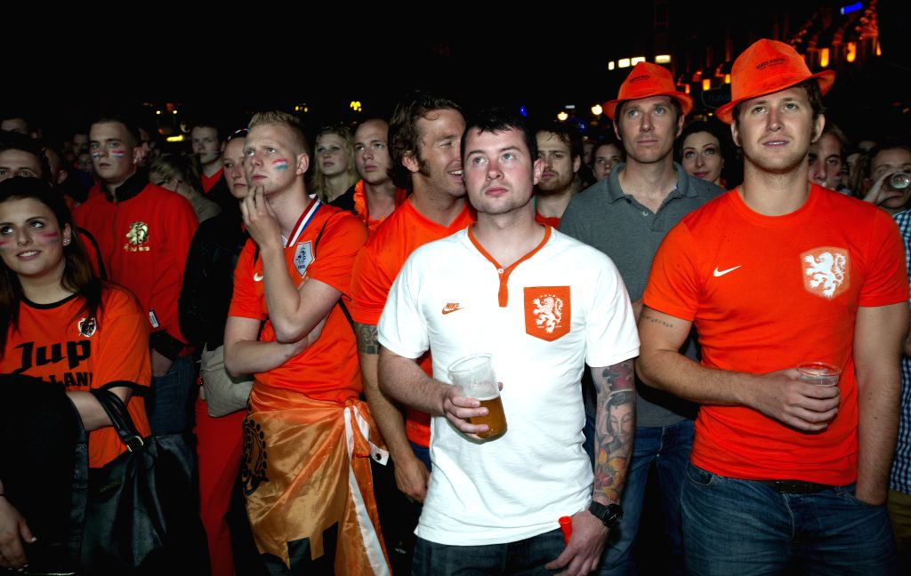 Fans watch the televised World Cup semi-final between the Netherlands and Argentina, in Rotterdam, the Netherlands, on July 9, 2014.