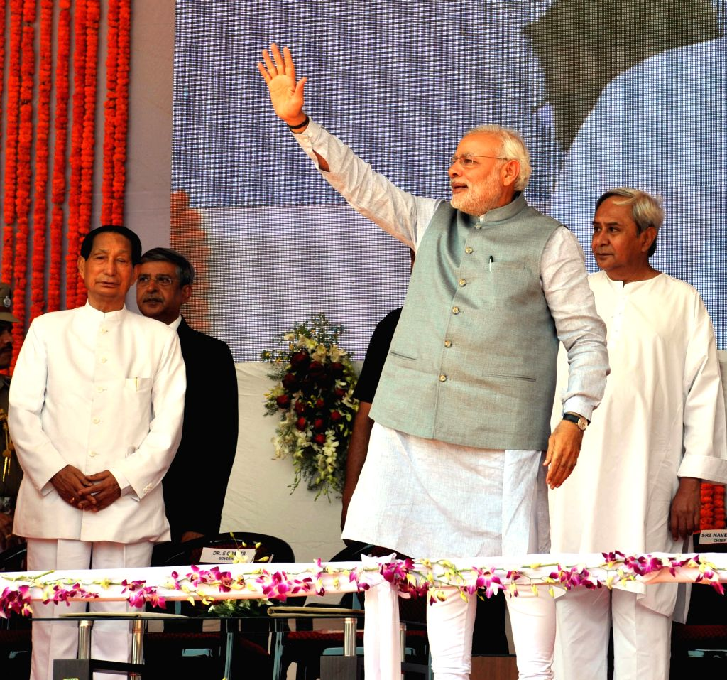 Prime Minister Narendra Modi during a programme organised at Rourkela Steel Plant to dedicate MT Expansion of the Plant to the nation, in Odisha on April 01, 2015. Also seen Governor of ... - Narendra Modi