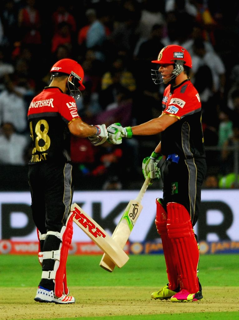 Royal Challengers Bangalore batsmen Virat Kohli and AB de Villiers during an IPL match between Rising Pune Supergiants and Royal Challengers Bangalore at Maharashtra Cricket Association Stadium ... - Virat Kohli