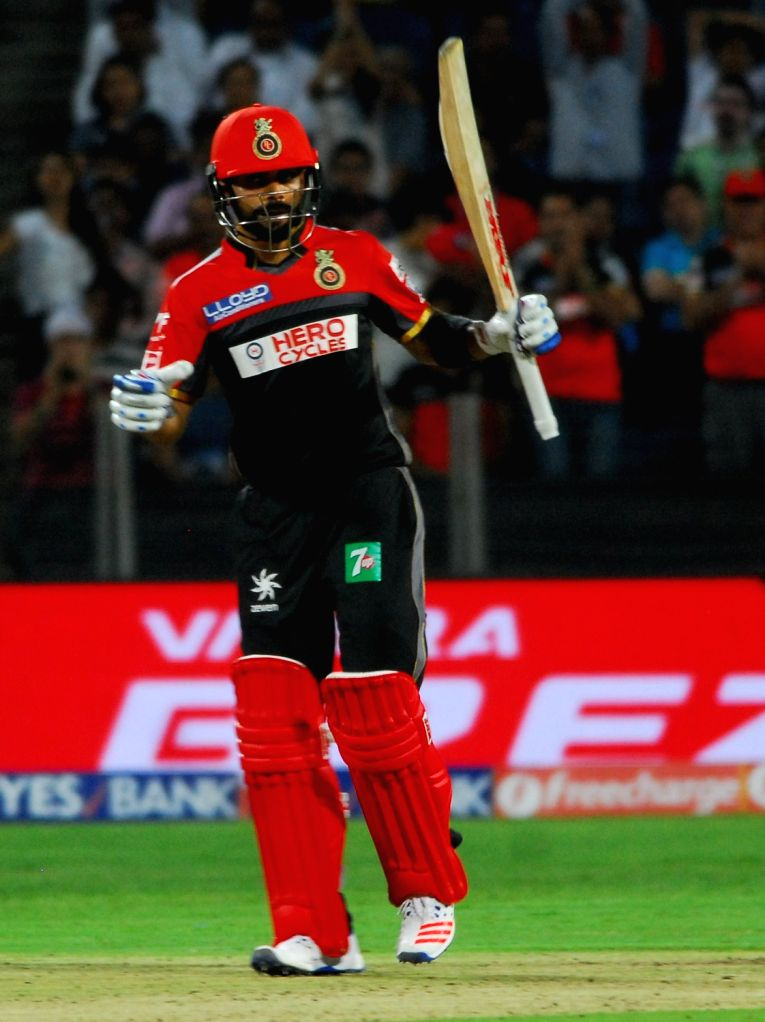 Royal Challengers Bangalore captain Virat Kohli celebrates his half century during an IPL match between Rising Pune Supergiants and Royal Challengers Bangalore at Maharashtra Cricket ... - Virat Kohli