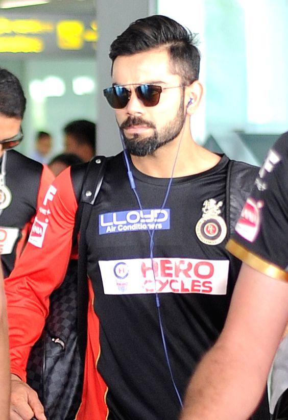 Royal Challengers Bangalore captain Virat Kohli arrives at Kolkata airport on May 15, 2016. - Virat Kohli