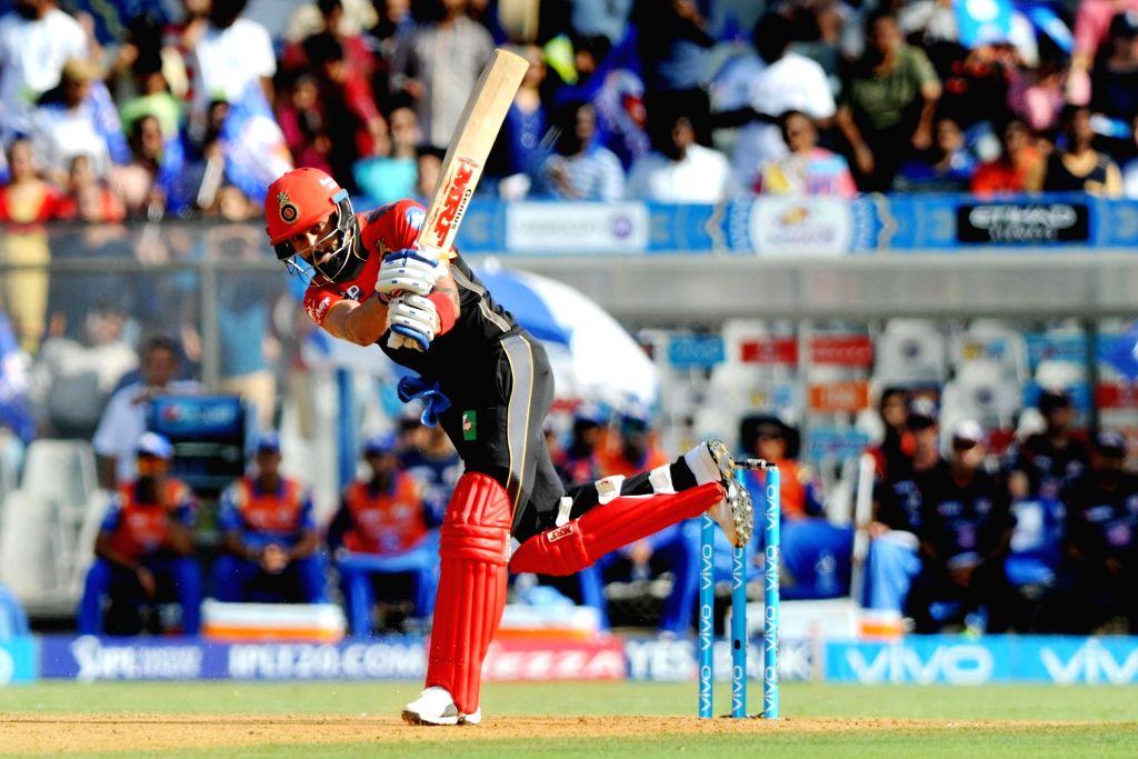Royal Challengers Bangalore captain Virat Kohli plays a shot during an IPL 2017 match between Mumbai Indians and Royal Challengers Bangalore at at Wankhede Stadium in Mumbai on May 1, 2017. - Virat Kohli
