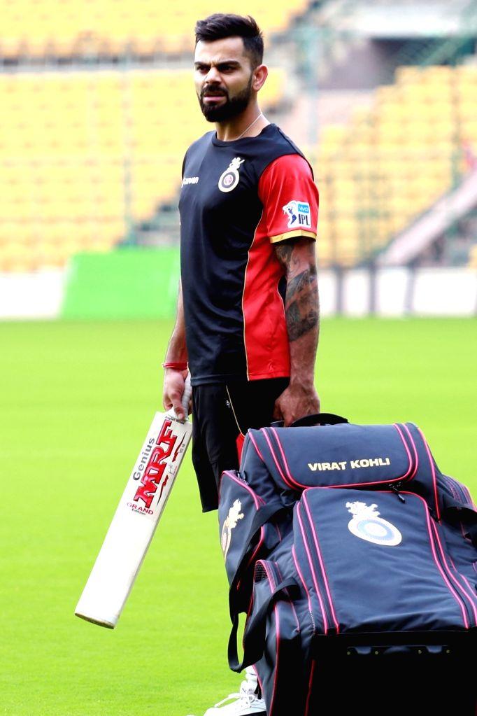 Royal Challengers Bangalore captain Virat Kohli during a practice session ahead of IPL 2018 at M. Chinnaswamy Stadium in Bengaluru, on April 3, 2018. - Virat Kohli