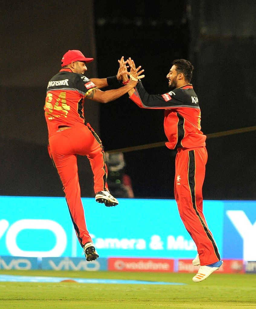 Royal Challengers Bangalore celebrate fall of a wicket during an IPL 2017 match between Royal Challengers Bangalore and Rising Pune Supergiant at M Chinnaswamy Stadium in Bengaluru on ...