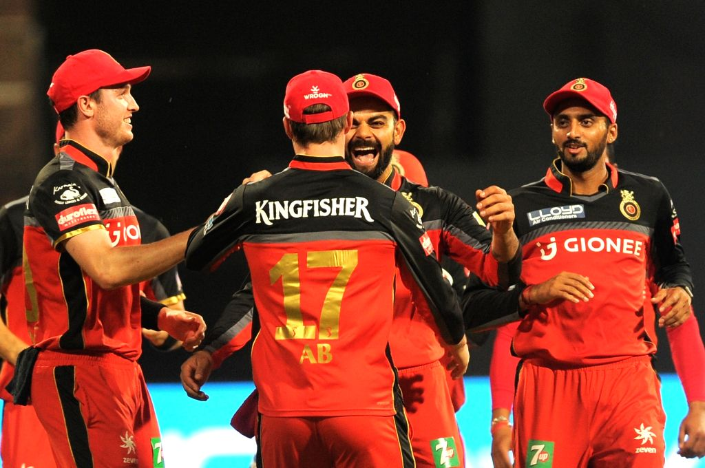 Royal Challengers Bangalore players celebrate fall of a wicket during an IPL 2017 match between Royal Challengers Bangalore and Rising Pune Supergiant at M Chinnaswamy Stadium in Bengaluru ...