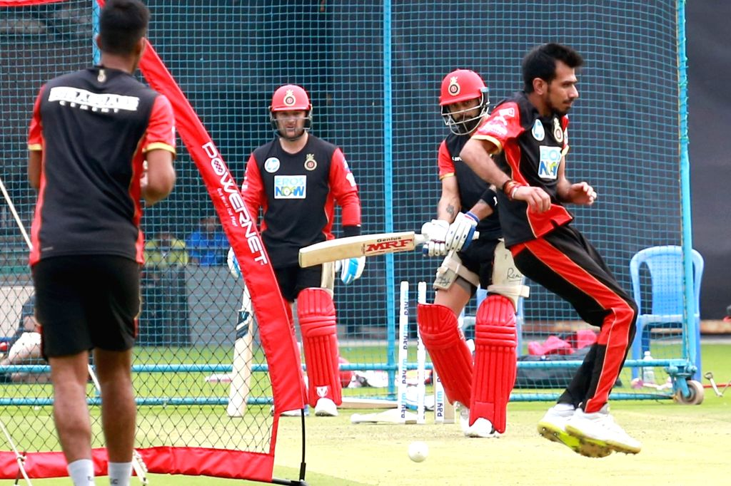 Royal Challengers Bangalore players during a practice session ahead of IPL 2018 at M. Chinnaswamy Stadium in Bengaluru, on April 3, 2018.
