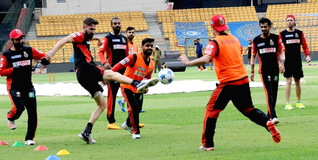 Royal Challengers Bangalore players in action during a practice session at M Chinnaswamy Stadium in Bengaluru, on May 27, 2016.
