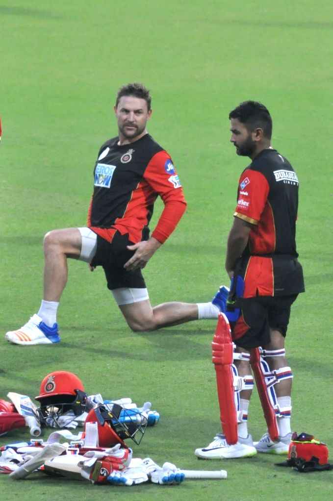 Royal Challengers Bangalore (RCB) players Brendon McCullum and Parthiv Patel during a practice session at Eden Gardens in Kolkata on April 6, 2018. - Parthiv Patel