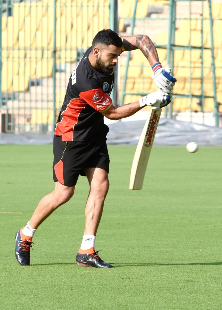 Royal Challengers Bangalore (RCB) skipper Virat Kohli during a practice session ahead of IPL 2018 at Chinnaswamy Stadium, in Bengaluru on April 4, 2018. - Virat Kohli