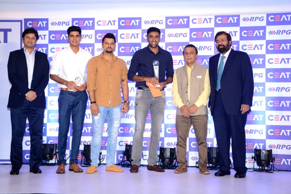 RPG Enterprises Chairman Harsh Goenka, CEAT MD Anant Goenka with cricketers Suresh Raina, Ravichandran Ashwin, Sunil Gavaskar at CEAT Cricket Rating Awards 2017 in Mumbai on May 24, 2017. - Anant Goenka