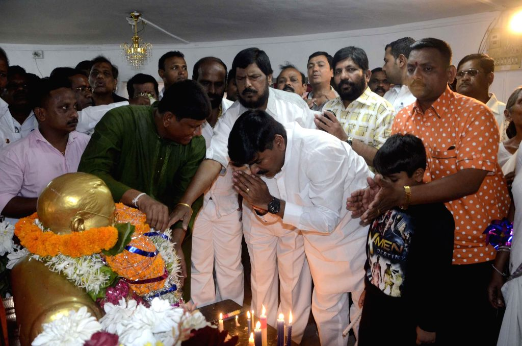 RPI chief Ramdas Athawale and Shiv Sena leader Rahul Shewale pay tribute to Dr. BR Ambedkar on his birth anniversary at Chaitya Bhoomi in Mumbai on April 14, 2014.