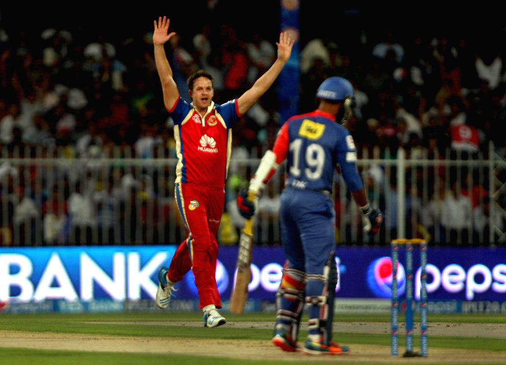 RSB bowler Albie Morkel celebrate fall of wicket during the second match of IPL 2014 between Delhi Daredevils and Royal Challengers Bangalore, played at Sharjah Cricket Stadium in Sharjah of United .. - Albie Morkel