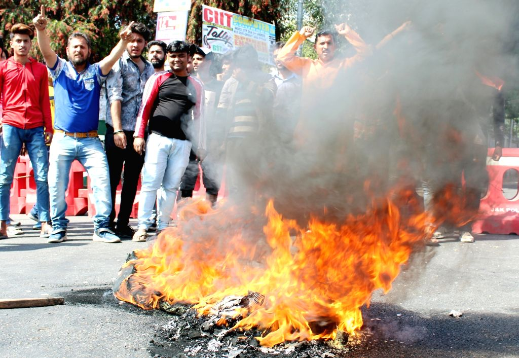 RSS activists burn tires as they protest against the killing of RSS leader Chandrakant Singh and his personal security officer by a militant, in Jammu and Kashmir's Kishtwar on April 9, ... - Chandrakant Singh
