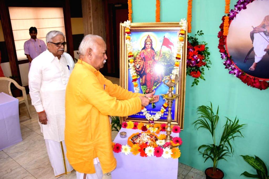 RSS chief Mohan Bhagwat lights the lamp to inaugurate a programme organised on the sidelines of Akhil Bhartiya Karyakari Manda, in Bhubaneshwar on Oct 16, 2019. The RSS has seen a sharp ... - Narendra Modi