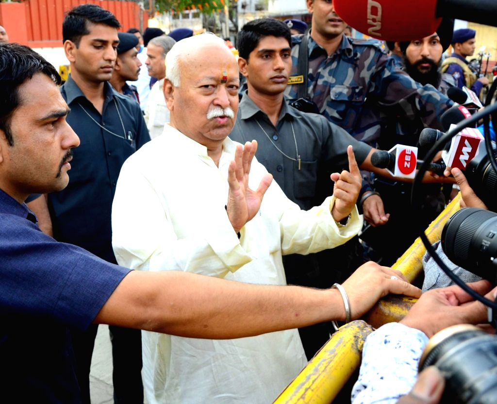 RSS chief Mohan Bhagwat shows his inked finger after casting vote for Lok Sabha election at a polling station, in Nagpur, on April 11, 2019.