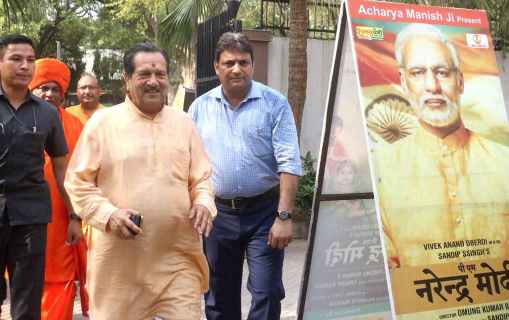 "RSS leader Indresh Kumar at the screening of upcoming film ""PM Narendra Modi"" in New Delhi, on June 5, 2019. - Narendra Modi and Indresh Kumar"