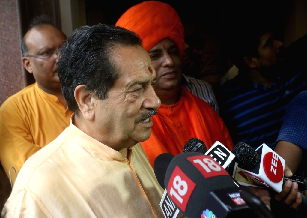 "RSS leader Indresh Kumar talks to the media persons at the screening of upcoming film ""PM Narendra Modi"" in New Delhi, on June 5, 2019. - Narendra Modi and Indresh Kumar"