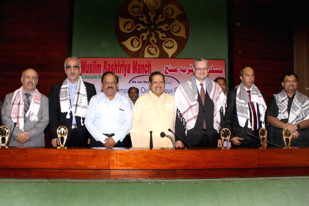 RSS senior leader Indresh Kumar and Union Minister for Science and Technology and Earth Sciences, Dr. Harsh Vardhan with the ambassadors of Muslim countries at a iftaar party organised by ... - Indresh Kumar