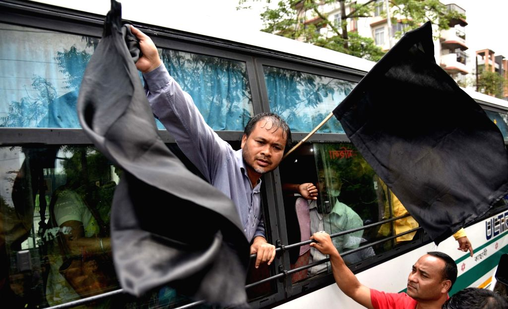 RTI activist and farmers' body leader Akhil Gogoi shows black flag as he is being taken away by police, in Guwahati on May 20, 2018. He was arrested on Sunday morning ahead of the BJP ... - Amit Shah