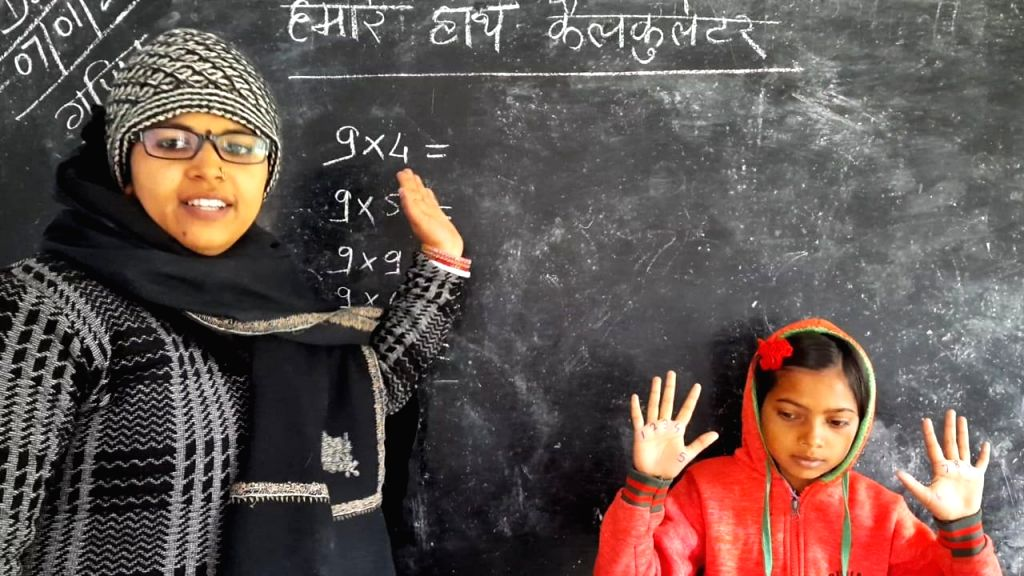 Rubi kumari teaches children.