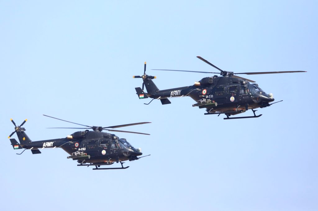 """Rudra Armed Utility Helicopter and Light Combat Helicopter perform during the inauguration of the """"Aero India 2019"""" - air show at Yelahanka Air Force Station, in Bengaluru, on ..."""