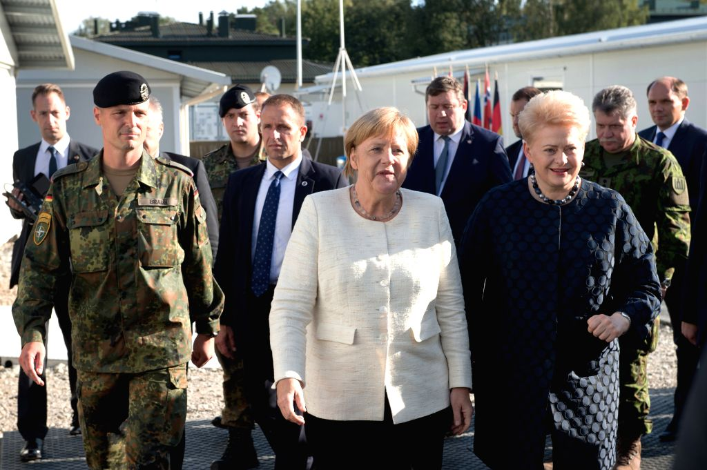 RUKLA (LITHUANIA), Sept. 14, 2018 Lithuanian President Dalia Grybauskaite (R, Front) and German Chancellor Angela Merkel (C, Front) visit the NATO multinational battalion in Rukla, ...