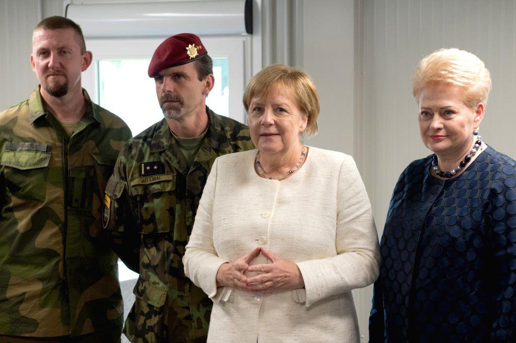 RUKLA (LITHUANIA), Sept. 14, 2018 Lithuanian President Dalia Grybauskaite (1st R) and German Chancellor Angela Merkel (2nd R) visit the NATO multinational battalion in Rukla, Lithuania, ...