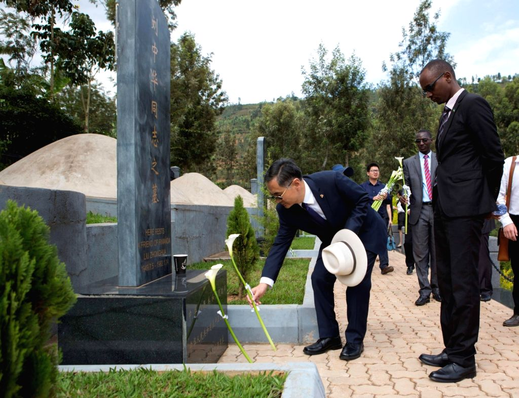 RULINDO (RWANDA), Sept. 30, 2017 Chinese Ambassador to Rwanda Rao Hongwei (L) lays a flower at a tombstone of a Chinese aid worker who died when working in aid projects for Rwanda at the ... - Rao Hongwei