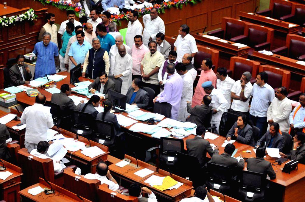 Ruling party and opposition party MLAs at Karnataka Legislative Assembly at Suvarna Soudha, in Belagavi on June 29, 2015.