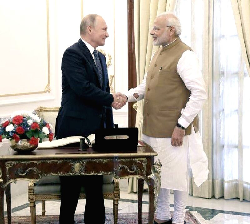 """Russia on Friday announced its highest order -- the Order of St Andrew the Apostle -- for Prime Minister Narendra Modi for """"distinguished achievement"""" in developing bilateral strategic relations. - Narendra Modi"""