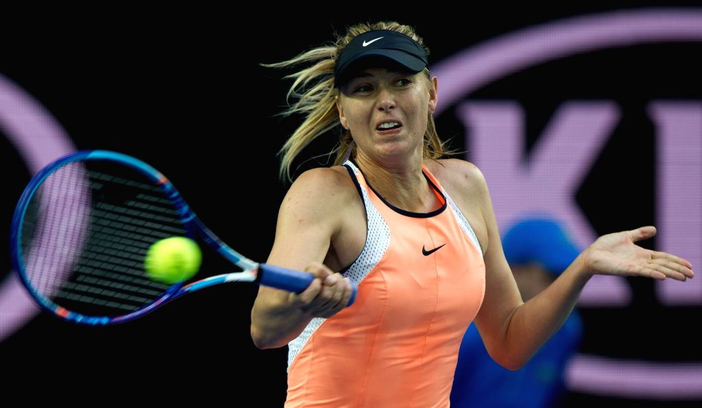 Russia's Maria Sharapova returns the ball during the first-round match of women's singles of Australian Open Tennis Championships against Nao Hibino of Japan at ...