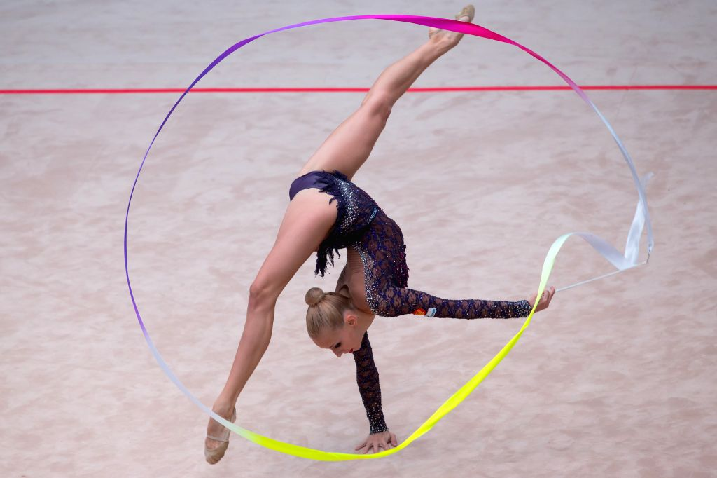 Russia's Yana Kudryavtseva performs with the ribbon during the individual all-around competition at the Hungarian Rythmic Gymnastics World Cup in Budapest, Hungary ...