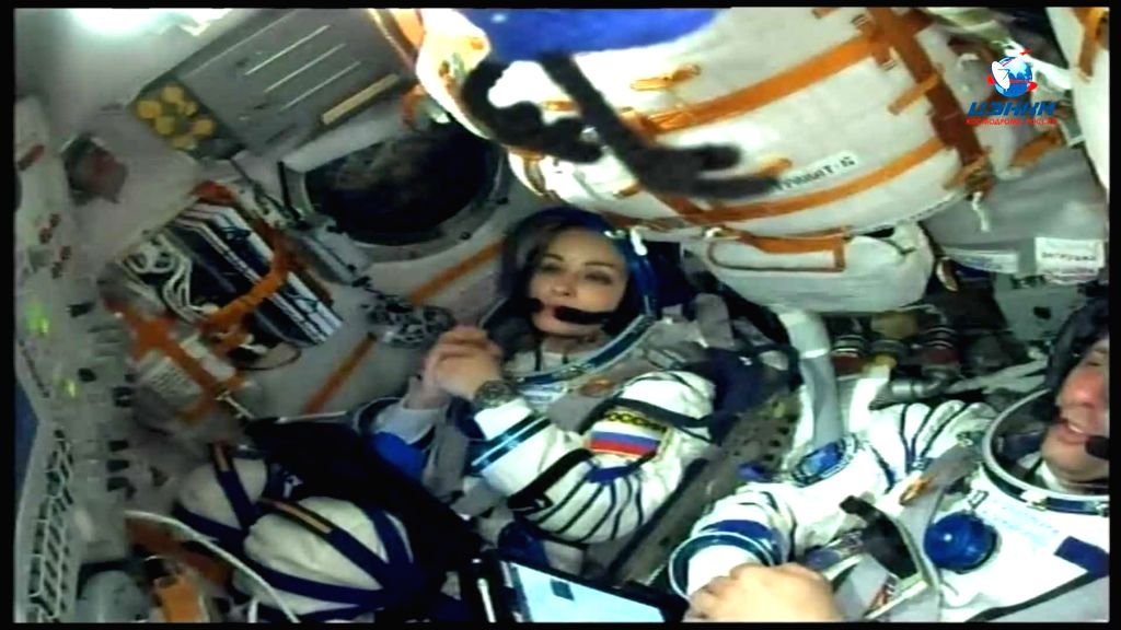 Russian film crew docks on space station to shoot movie. Credit: Roscosmos/Twitter