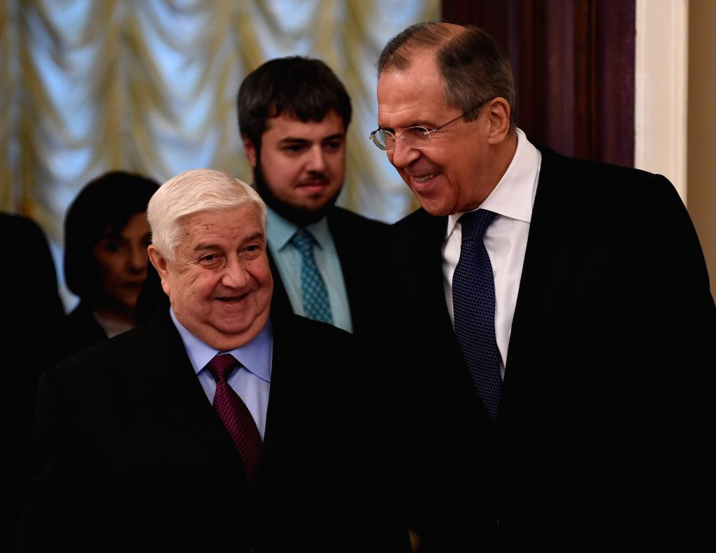 Russian Foreign Minister Sergei Lavrov (R) and his visiting Syrian counterpart Walid Al-Moualem attend a press conference in Moscow, Russia, on Nov. 27, 2015. Russia ... - Sergei Lavrov