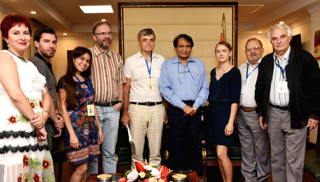 Russian journalists call on Union Commerce and Industry and Civil Aviation Minister Suresh Prabhakar Prabhu as part of familiarization programme, in New Delhi on Sept 18, 2018. - Suresh Prabhakar Prabhu