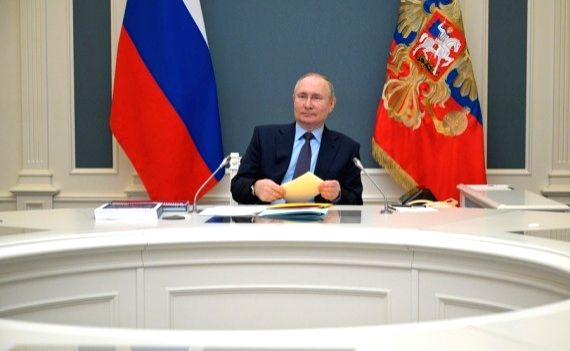 Russian President Vladimir Putin attends a meeting of the Board of Trustees of the Russian Geographical Society via video link on April 14, 2021. (Kremlin photo)