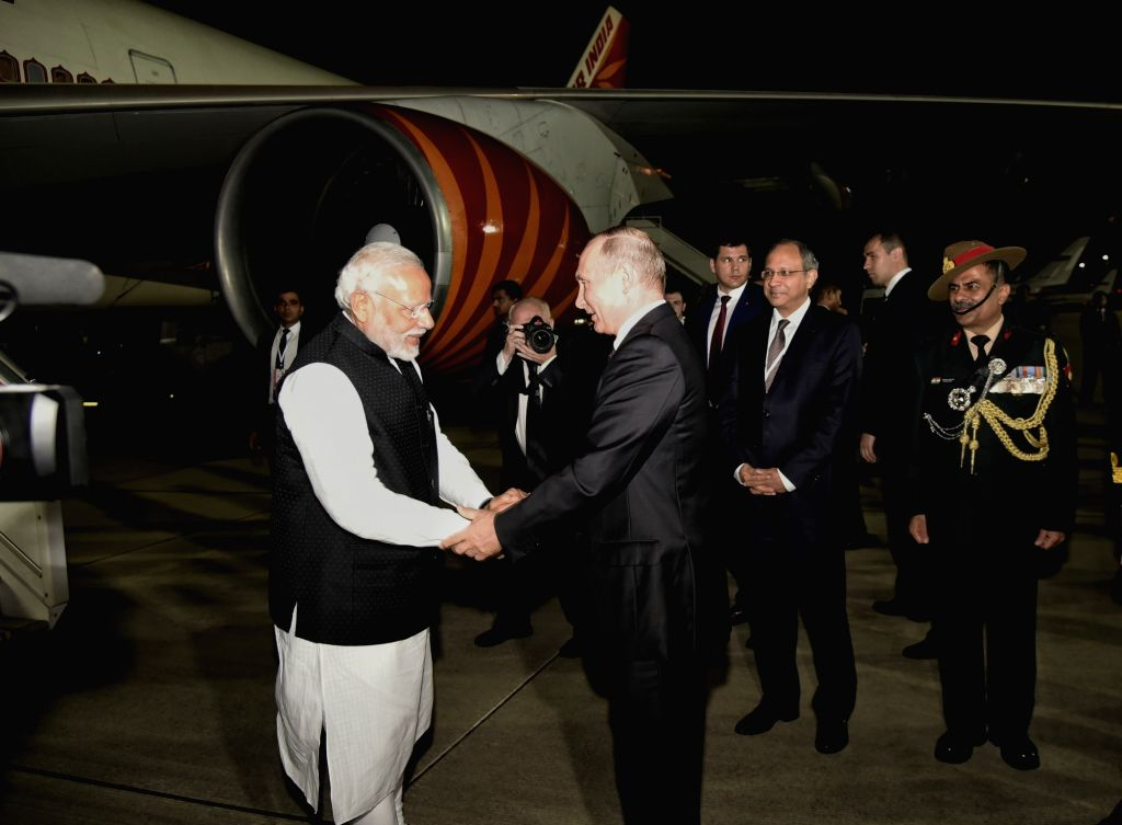 Russian President Vladimir Putin sees off Prime Minister Narendra Modi as he departs for India from Sochi after successful completion of his 1-day visit to Russia, on May 21, 2018. - Narendra Modi