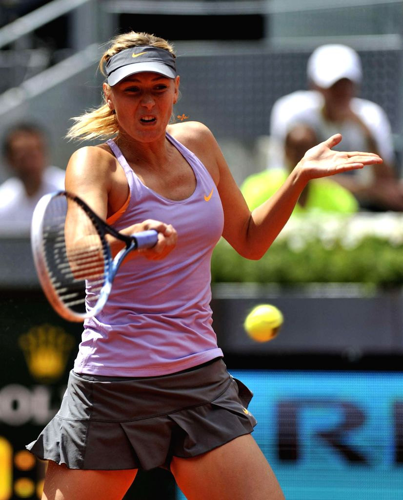 Russian tennis player Maria Sharapova in action against her American counterpart Christina McHale during second round match of the WTA Madrid Open singles in Madrid, Spain on May 6, 2014. Sharapova ..