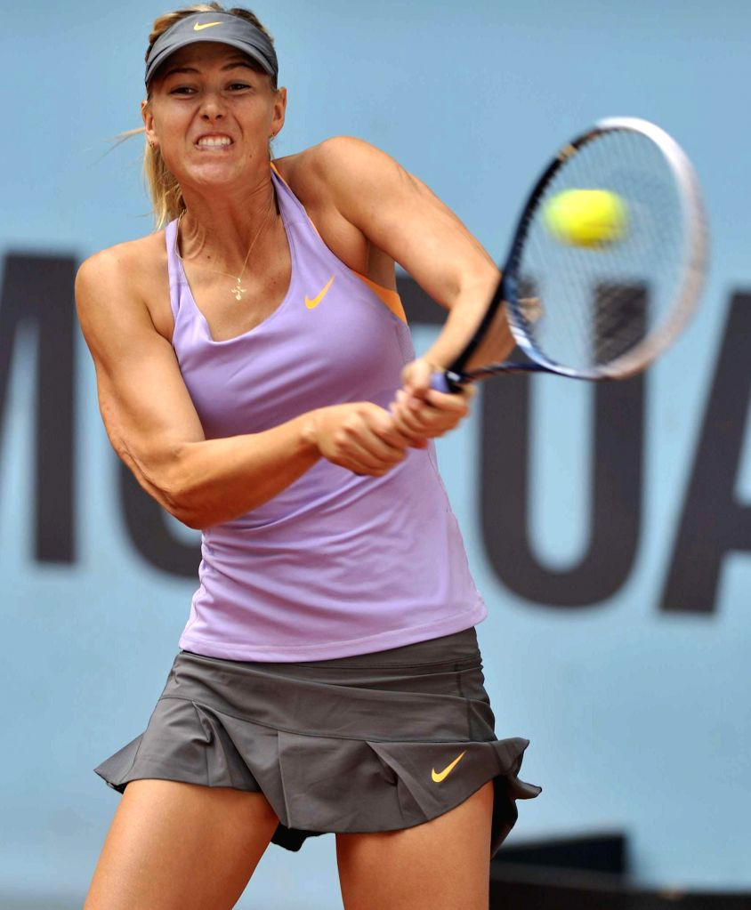 Russian tennis player Maria Sharapova in action against her Australian counterpart Samantha Stosur during the third round match of the WTA Madrid Open women's singles in Madrid, Spain on May 8, 2014.