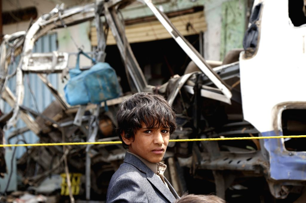 SAADA, Aug. 12, 2018 - A boy stands at the site of an airstrike in Dhahyan, Saada province, Yemen, on Aug. 12, 2018. Warplanes of the Saudi-led coalition targeted passenger buses in the Dhahyan ...