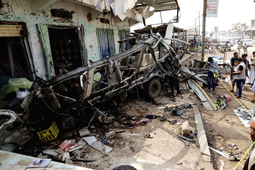 SAADA, Aug. 12, 2018 - A bus wreck is seen at the site of an airstrike in Dhahyan, Saada province, Yemen, on Aug. 12, 2018. Warplanes of the Saudi-led coalition targeted passenger buses in the ...