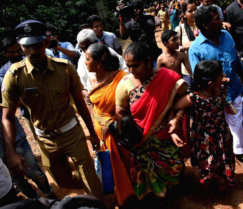 :Sabarimala: Women devotees attempt to enter Sabarimala temple in Kerala's Pathanamthitta District on Oct 17, 2018. Traditionalists opposed to the entry of women in the 10-50 age group to the ...
