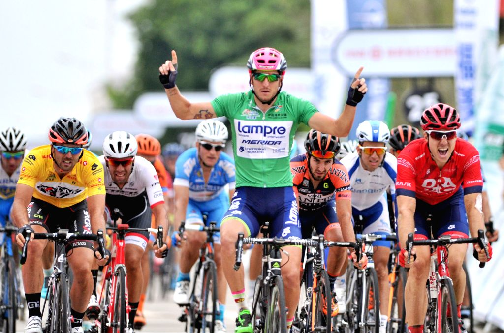 Sacha Modolo (C) from Lampre-Merida celebrates after he crossed the finish line after the 4th stage of the 2015 Tour of Hainan International Road Cycling Race in ...